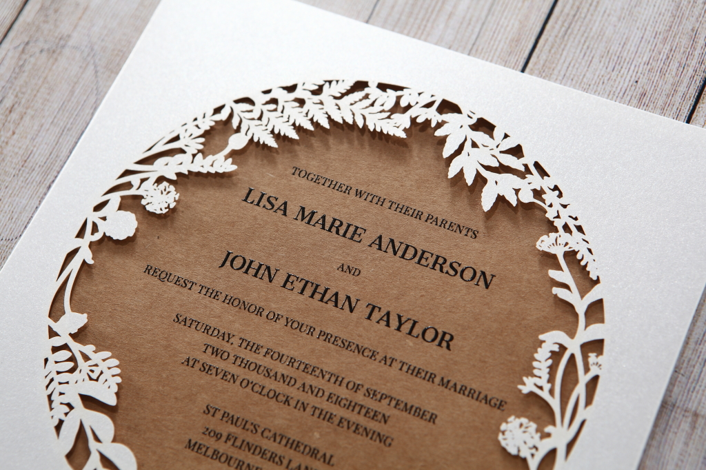 Earthy rustic wedding invitation with laser cut boarder