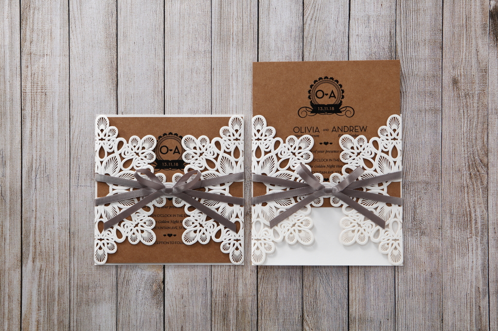 A rustic wedding invitation with lace and ribbon