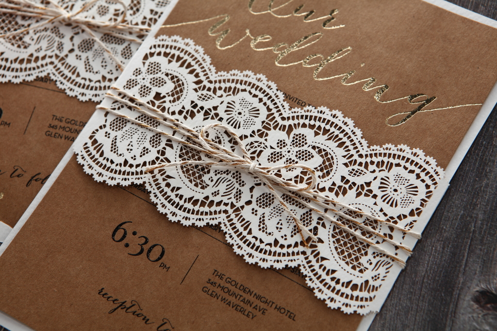Lasercut wedding invitation with lace and gold foiling