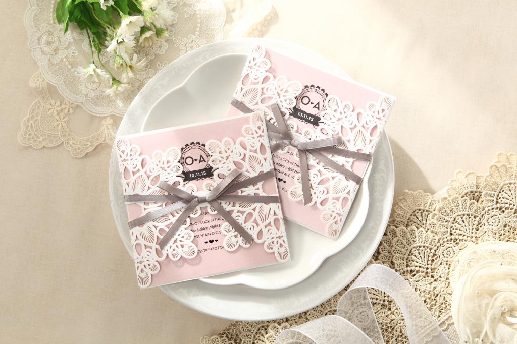 laser-cut-blushing-pink-ribbon-invitation