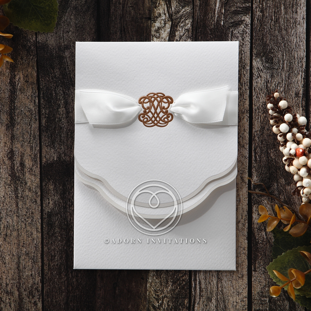 Classic white trifold invite wrapped in silky white ribbon with exquisite gold foiled monogram