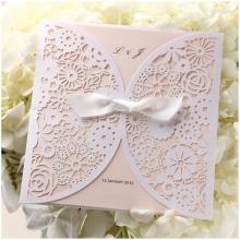 Floral laser cut pocket adprned with ribbon