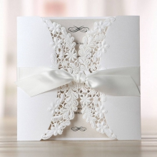 Radiant white floral laser cut invite with silky ribbon