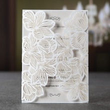 Gate-fold invite with intimate floral laser cut pocket