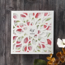 Floral laser cut invite with water coloured background