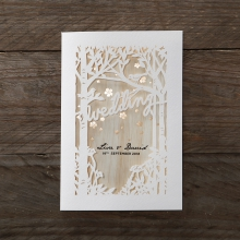 Forest themed laser cut invite with gold foiled flower background