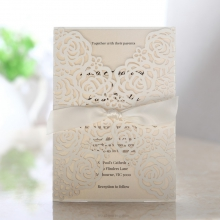 Floral laser cut pocket secured with pearl cream ribbon