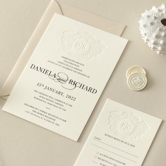 black_foil_wedding_invite_with_blind_letterpress_crest