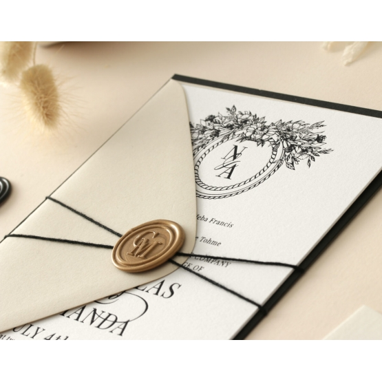black_foiled_cotton_invite_with_wax_seal