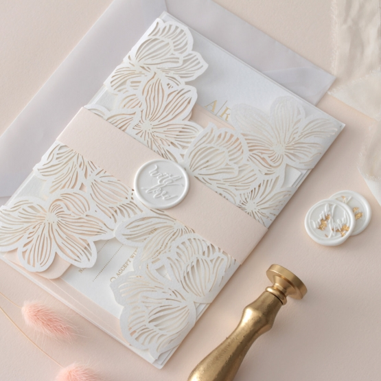 laser_cut_floral_invite_with_pastel_band_and_wax_seal