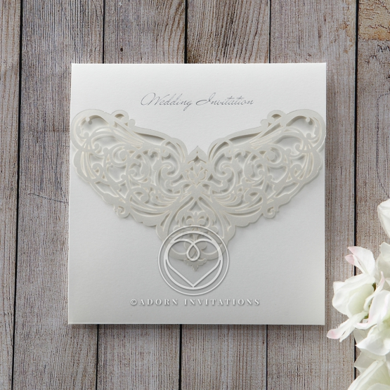 Silver foiled cover of tri fold Victorian patterned laser cut invite