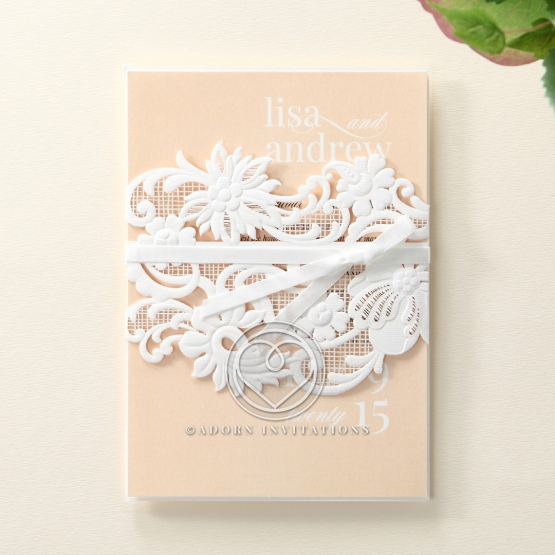 Ribbon designed laser cut sash with flower theme wrapped in a salmon coloured insert