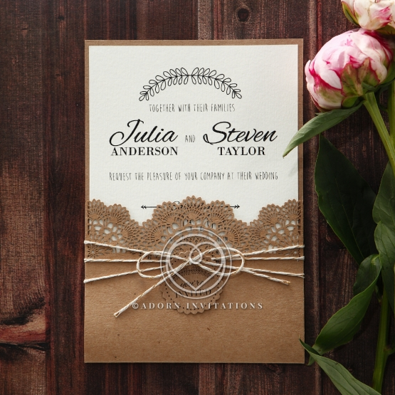 Craft paper outer pocket with floral laser cut invite wrapped with twine