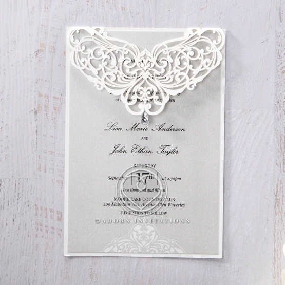 Victorian themed grey and white invite with laser cut sleeve embellished with jewel