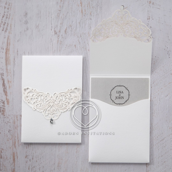 Silver grey card with monogram inserted to a matte pocket invitation with laser cut cover