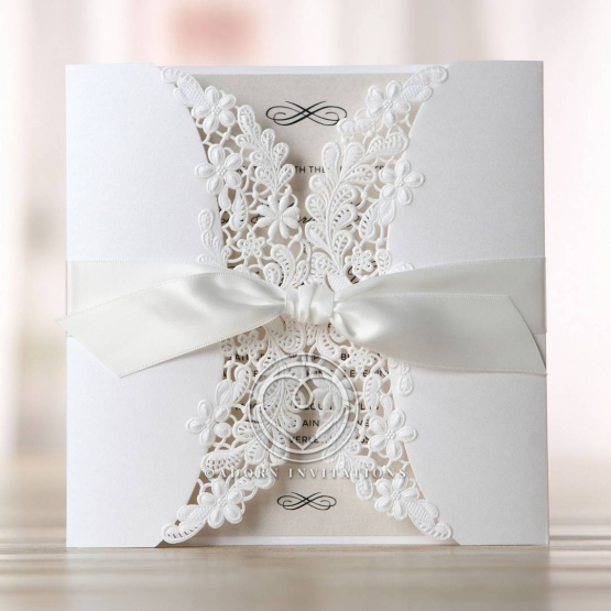 Flower inspired invite with white sleeve and create inner card featuring ribbon accent.