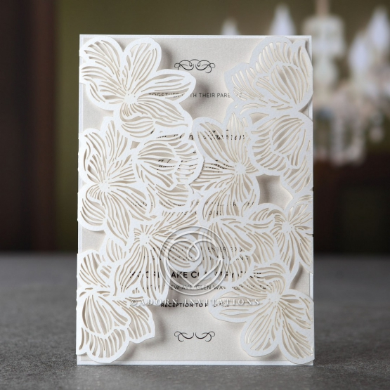 Summer themed floral invitations featuring lilies designed with laser cut technology