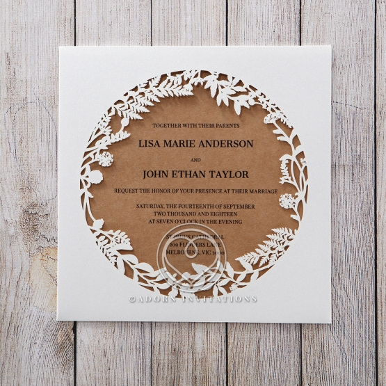 White laser cut invite with craft paper card