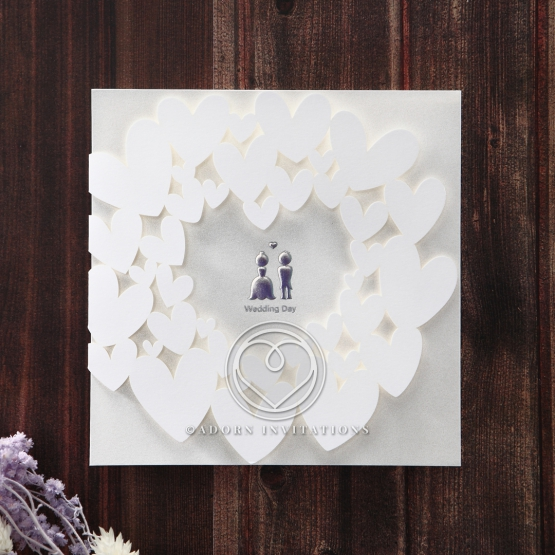 All white modern invitation featuring hearts and foiled bride and groom graphics