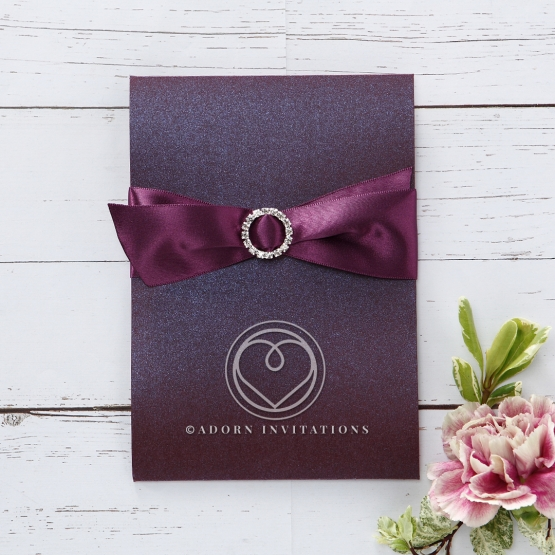 Pearl purple outer pocket wrapped in stunning ribbon with sparkling jewel detail