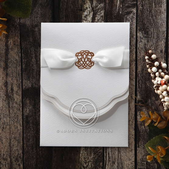 Folded white vintage invite with gold emblem