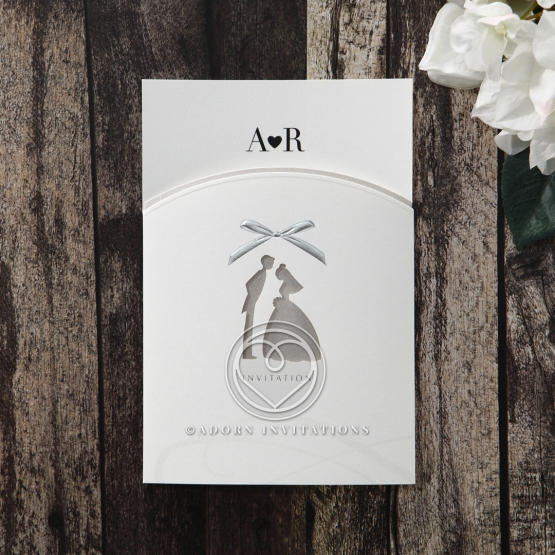 Uniquely shaped invite with an endearing bride and groom cutout center