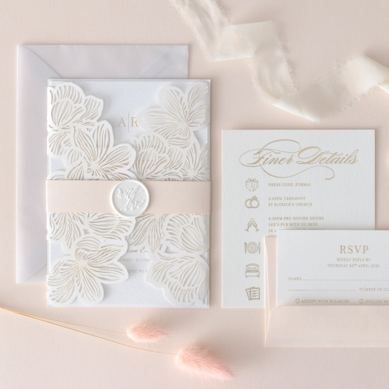 white_floral_laser_cut_with_accessory_cards_and_paper_band