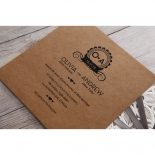 Brown card stock printed with bride and groom initials inside a modern emblem