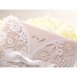 Initials of bride and groom in focus for the blush coloured floral wedding card