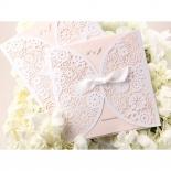 Blush invitation card inside a ribbon designed flower themed pocket