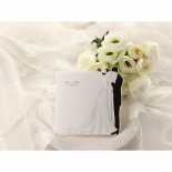 Traditional black and white tri fold invite with embossed bride and groom