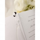 Wedding invitation unfolded with bride embossing