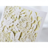 Detailed view of the precise flower laser cutting on white sleeve