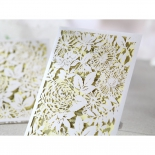 Cropped view of the nature themed yellow and white folded bridal invitation