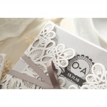Flower themed white gate of the bridal card in laser cut