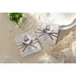 A pair of flower inspired white wrap invitations with ribbon