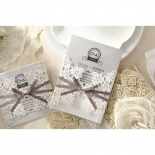 Two flower patterned invite sleeves featuring a grey, embossed ink printed card.