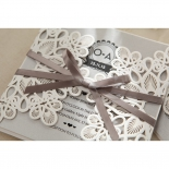 Gated flower patterned pocket invitation featuring a dark grey ribbon wrap.