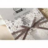 Square grey wedding card out of its ribbon adorned floral pocket