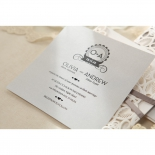 Grey flat card featuring black wedding wording on top of its matching pocket