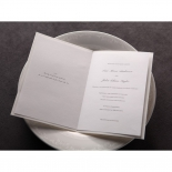 White themed classically styled wedding invitation with ribbon