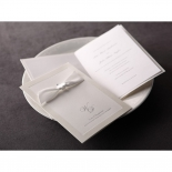 Wedding invitations with traditional style showcasing ribbons and letter pressed wording on cover