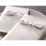 Classic white bridal invite with silk screened border