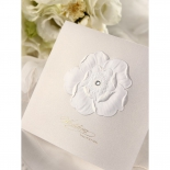 Sparkling crystal accentuating the flower embossed design on white pocket