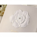 Gold foiled floral invitation accentuated with a jewel as pollen