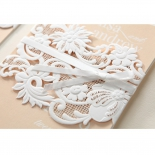 Matte flower themed wedding invite cover designed with laser cut lace patterns and ribbon
