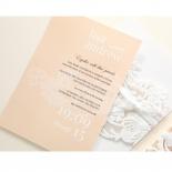 Raised ink text on salmon invite card in portrait orientation