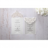Two identical invitations side by side featuring intricate laser cut sleeve in matte white