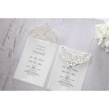 Two jeweled laser cut invitation beside each other with one's flap lifted