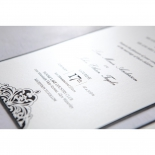 Wedding date raised text in focus on the white shimmer paper